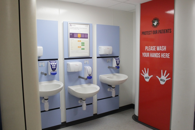 The Queen Elizabeth Hospital urges visitors not to attend hospital if they are experiencing vomiting, diarrhoea symptoms