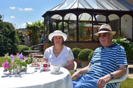 Celia and Philip Green enjoying tea and cake
