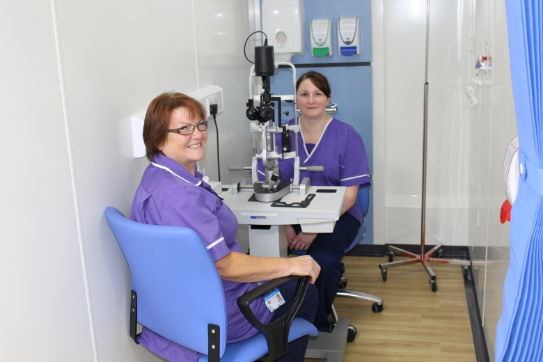 Allison Boughnimi and Hannah McGill at the eye examination machine